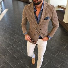 Marry a brown check sport coat with white chino pants if you're going for a neat, stylish look. A pair of camel suede tassel loafers will bring a strong and masculine feel to any ensemble. Shop this look on Lookastic: https://lookastic.com/men/looks/blazer-dress-shirt-chinos/24026 — Blue Dress Shirt — Navy Floral Pocket Square — Brown Check Blazer — Tan Bracelet — Dark Brown Leather Watch — Dark Brown Leather Belt — Dark Brown Sunglasses — White Chinos — Tan Suede Tassel Loafers ...