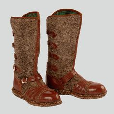 Womans winter boots, the so-called kapce. Made of wool reinforced and decorated with stitched on brown leather. On the backside, leather straps which imitate fastening. Sole made of wool.  Podhalanian Highlanders, Zakopane area, early 1990s.