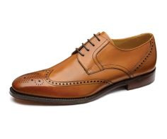 Premium wingtip brogue shoe, made with burnished calf leather, using the narrow fit 'Duke' last shape. Made in England.