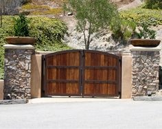 We custom build and design all styles of wrought iron gates and feature full installations! Front Gate Design, House Gate Design, Door Gate Design, Garage Door Design, Gate House, Wooden Gate Designs, Wooden Gates, Front Gates, Entrance Gates