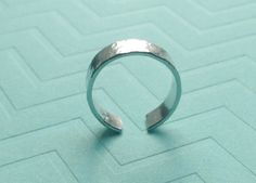 A personal favorite from my Etsy shop https://www.etsy.com/listing/227757768/sterling-silver-ring-hammered-adjustable