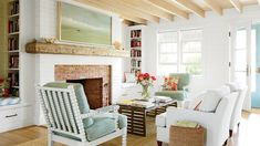 "Traditional beach cottage interiors call for light, bright materials: Think painted, textured shiplap walls, cypress ceilings with exposed rafters, and cerused white oak floors chosen to mask the sand tracked in from the beach. ""The idea was to make thing"