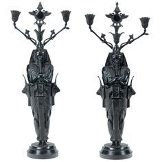 Unusual Pair of Egyptian Revival Candelabra | From a unique collection of antique and modern candleholders and candelabra at https://www.1stdibs.com/furniture/lighting/candleholders-candelabra/
