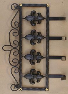 """Steel base, gold screw accents 2 key holes on the back for hanging. Measures: 16"""" length X 12"""" height"""