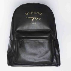 Defend Paris Men's AK Leather Backpack Men's large faux leather backpack with gold lettering and accents. Soft leather exterior and black microfiber interior. Never used. Brand new. Comes with certificate of authenticity. Excellent spacious bag for traveling in style. Defend Paris Bags Backpacks