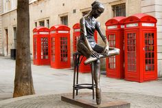 Red Telephone Boxes - These are the ones in Bow Street, opposite the entrance to the Royal Opera House. The statue 'Young Dancer', by Enzo Plazzotta provides some useful foreground interest.