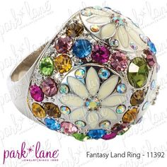 Fantasy Land Ring: Dancing butterflies, hand-enameled in shades of plum and pink. Multi-color crystals and daisies embellish the dome ring and radiate a glittering rainbow. $138