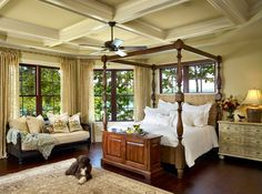 Traditional Master Bedroom with Ceiling fan, Window seat, Built-in bookshelf, Standard height, Hardwood floors, Exposed beam