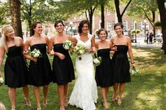 knee length black bridesmaids dresses with colored sashes and flowers and shoes and jewelry