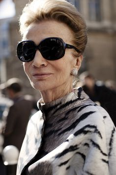 #Glam oversized shades, hair pulled back, classic studs with a dash of animal print are right on #Trend