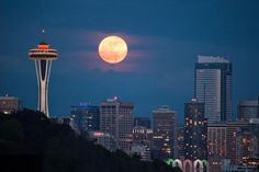 """Seattle Skyline @ Night. Photo of """"Supermoon"""" as it rises over Seattle on May 5, 2012. (Photo ©Liem Bahneman)"""