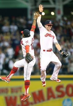 Cleveland Indians Francisco Lindor celebrates with Tyler Naquin after defeating…