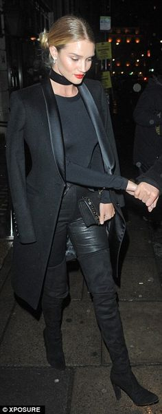 Impeccable dress sense: The top model looked simply stunning as she picked out a semi-sheer top, leather trousers, heeled thigh-high boots and a tailored coat for the evening out with her actor fiancé
