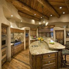 Gorgeous tuscan-style kitchen design! Love the ceiling, island and walls. | http://www.homechanneltv.com/photos-kitchen-designs.html