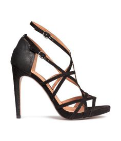 Sandals in imitation suede and snakeskin-patterned imitation leather. Adjustable ankle straps with metal buckle. Rubber soles. Front platform height 1/2 in., heel height approx. 4 1/2 in.
