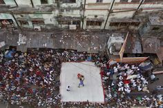 Wrestlers fought during an amateur match inside a makeshift ring built in an road in Kolkata Wednesday. (Rupak De Chowdhuri/Reuters)