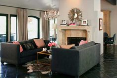 living room furniture in gray color and decorative pillows in pink color like the fire place also