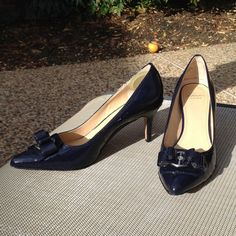 """Circa Joan & David Luxe Pumps Classic Joan & David pumps. Beautiful navy patent leather with front bow with metal circle with small engraved cjd (circa joan david) two small scuff marks as shown in pics- very hard to see. 3"""" heel. Bows still have styrofoam in them to maintain shape. Joan & David Shoes Heels"""