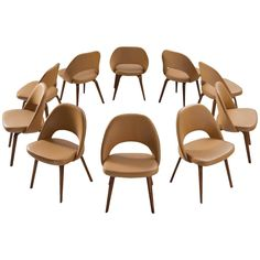 Eero Saarinen Chairs for Knoll in Original Beech and Faux Leather   From a unique collection of antique and modern dining room chairs at https://www.1stdibs.com/furniture/seating/dining-room-chairs/