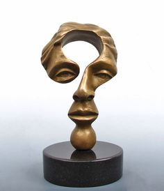 """Surreal symbolic sculptures by Michael Alfano (New Yorker in Hopkinton, Massachusetts) 2013 • depicted: ? head • Alfano interprets philosophical ideas """"The best art engages, generates discussion, and brings about change. My art compels viewers to experience, think, and understand life more fully."""" • materials artist uses: bronze / cold cast copper / resin"""