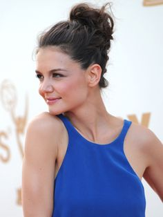 Katie Holmes  Texture is the name of the game for Mrs. Cruise's laid-back bun. To recreate this look at home, secure your updo then spritz fingers with hairspray and gently loosen the roots to add volume and dimension to too-formal hairstyles.