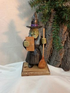 This hand carved witch wood sculpture is so ugly that shes cute. From her pointed hat to her pointed chin she if full of charm and great