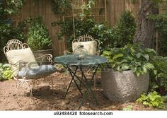 GARDENS: pine needles create a patio base for a seating area