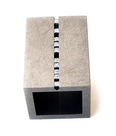 Yael Herman  Ring: Waterfall 2005  Stainless Steel ring with sliding diamonds in an endless groove