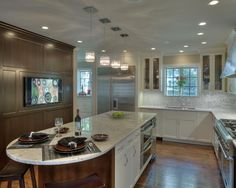 white cabinets, marbel backsplash, double oven in the island