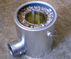 Homemade TIN CAN Rocket Stove - DIY Rocket Stove - Awesome Stove! Homemade TIN CAN ROCKET STOVE. no special tools required. This stove is great! Items needed: 3 metal cans, gravelsand andor dirt! Add copper spiral pipe against (or in?) central can to crea Camping Survival, Outdoor Survival, Survival Prepping, Emergency Preparedness, Survival Gear, Survival Skills, Bushcraft Camping, Survival Stove, Apocalypse Survival