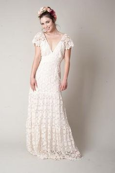 nais is a perfect bohemian style dress made from French style crocheted lace with a tiered skirt, v neckline, cap sleeve and a sash that ties in a bow at the back.