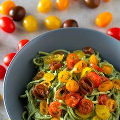 Zucchini Noodles with Avocado Sauce Recipe with zucchini, water, lemon juice, avocado, pinenuts, basil, cherry tomatoes