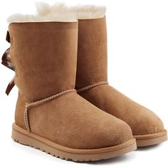 UGG Australia Bailey Bow Suede Boots (280 CAD) ❤ liked on Polyvore featuring shoes, boots, uggs, brown, brown shoes, brown suede shoes, rounded toe boots, suede leather boots and calf length boots