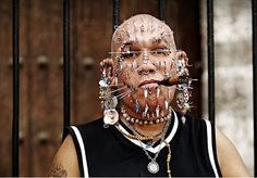 """Luis Antonio Aguero """"Piercing-king"""" Luis Antonio Aguero Torregosa has over 300 holes in his face, and believe it or not, he will fill all of them with metal. Guinness World Record 1993 . Wtf Face, Crazy People, World Records, Piercing, Things To Think About, Crazy Faces, Beautiful, Continue Reading, Ears"""