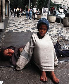 homeless children in Brazil, this photo shows what belongings and clothes homeless people have.