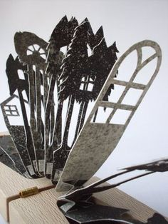 Hidden Etching by Lizzie Thomas - Hand cut and hand printed paper | This Pop-Up, made of hand cut and hand printed paper, is inspired by the meaning of the house and the forest in fairytales. #paper_cutting #sculpture #woodwork
