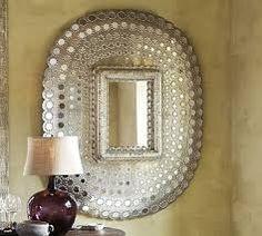 Maison Malou loves this gorgeous silver peacock mirror!