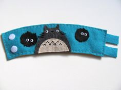 Etsy Totoro felt cozy was hand sewn and stitched. Complete with dust spirits and googly eyes.