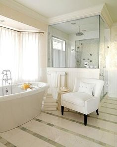 Loving white subway tiles and striped floor tiles in the bathroom.