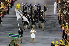 RIO DE JANEIRO, BRAZIL - AUGUST 05: Flag bearer Rose Lokonyen Nathike of the Refugee Olympic Team leads her team during the Opening Ceremony of the Rio 2016 Olympic Games at Maracana Stadium on August 5, 2016 in Rio de Janeiro, Brazil. (Photo by Paul Gilham/Getty Images)