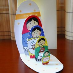 Matryoshka Doll Pop-Up card... the dolls pop up graduated by size ...