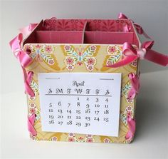 Cute little organizing box made from chipboard coasters (with calendar on one side and corkboard on another)