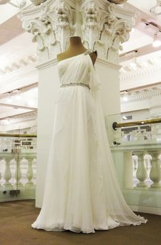 LOVE this as bridesmaids dress, shortened in champagne would be beautiful