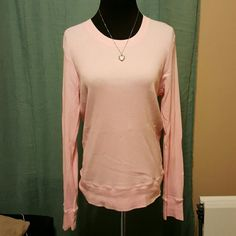 Baby pink Gap Thermal long sleeve Super soft and perfect for layering. Baby pink, with a banded waist. Adorable! Worn only a few times, small section of looses stiching shown in photo. GAP Tops Tees - Long Sleeve