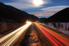 A slow shutter-speed at night with passing cars draws amazing light trails.
