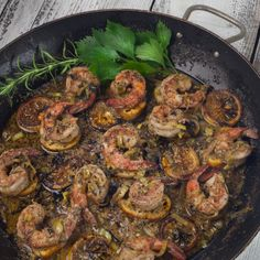 Jumbo shrimp bathed in a buttery bath of herbs and spices.  The perfect appetizer skillet. (All photos credit: George Graham)