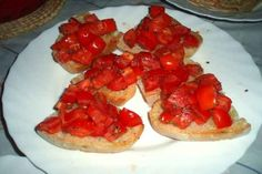 Make bruschetta with chopped tomatoes, salt, olive oil, and dried basil.