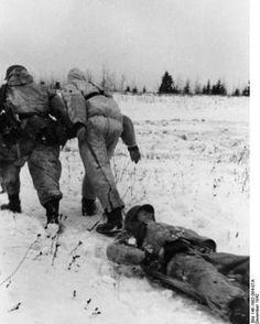 German soldiers saving a wounded comrade.