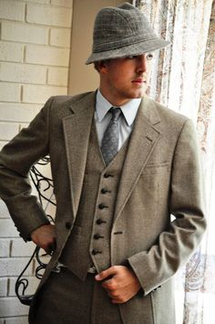 vintage suits for men - I love this look - the suit, waistcoat, shirt, tie, hat and slight touch of stubble, and (I am guessing) sleek wavy brushed back hair under the hat.
