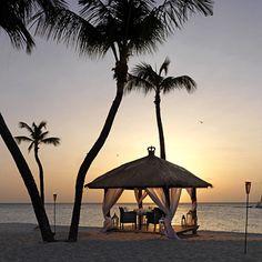 Private beach dinner for two, anyone? Check out Bucuti and Tara Beach Resorts in Aruba.